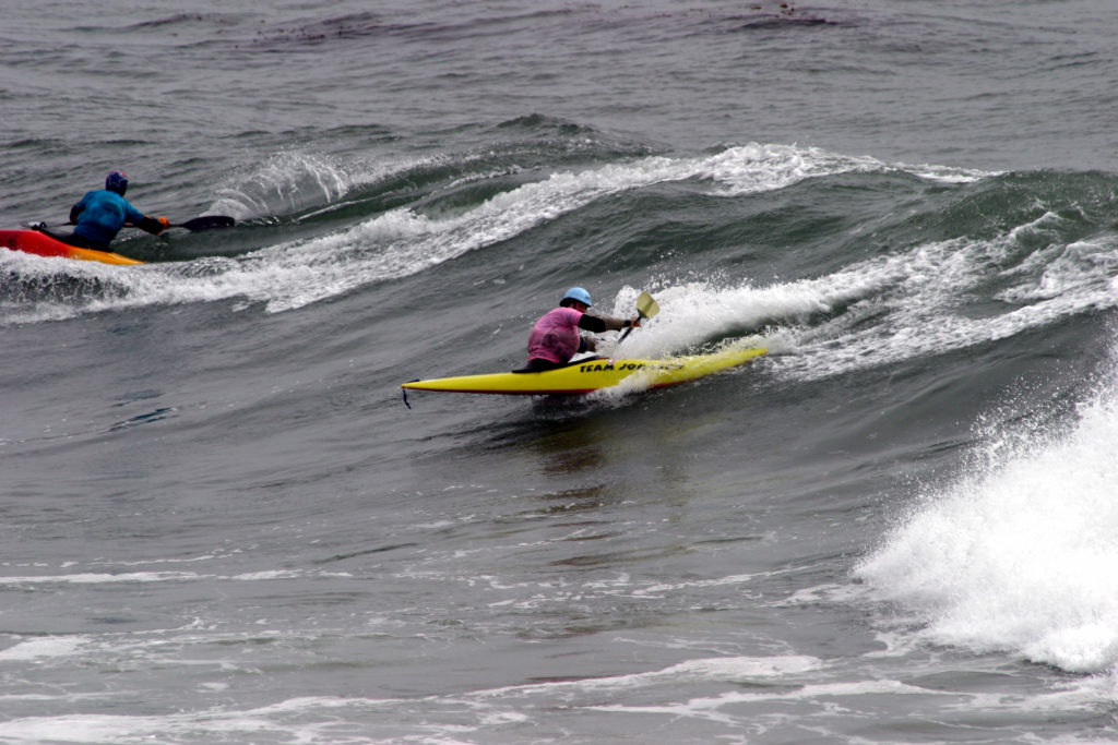 surf kayaking techniques - charging at a wave