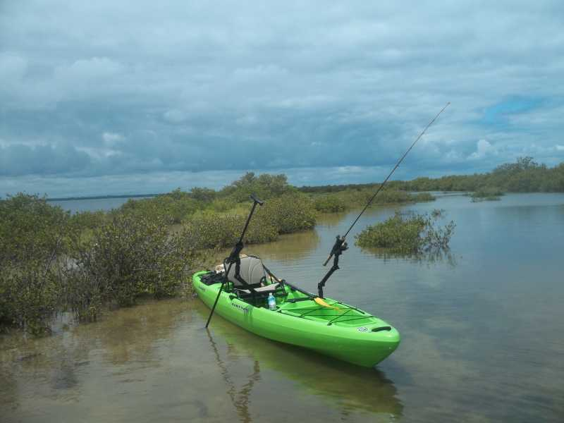 Native Watercraft Slayer Propel 13 fishing kayak in action with rods!